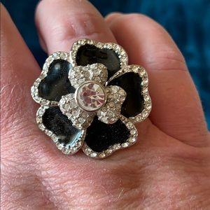 Black enamel and white crystal flower ring.